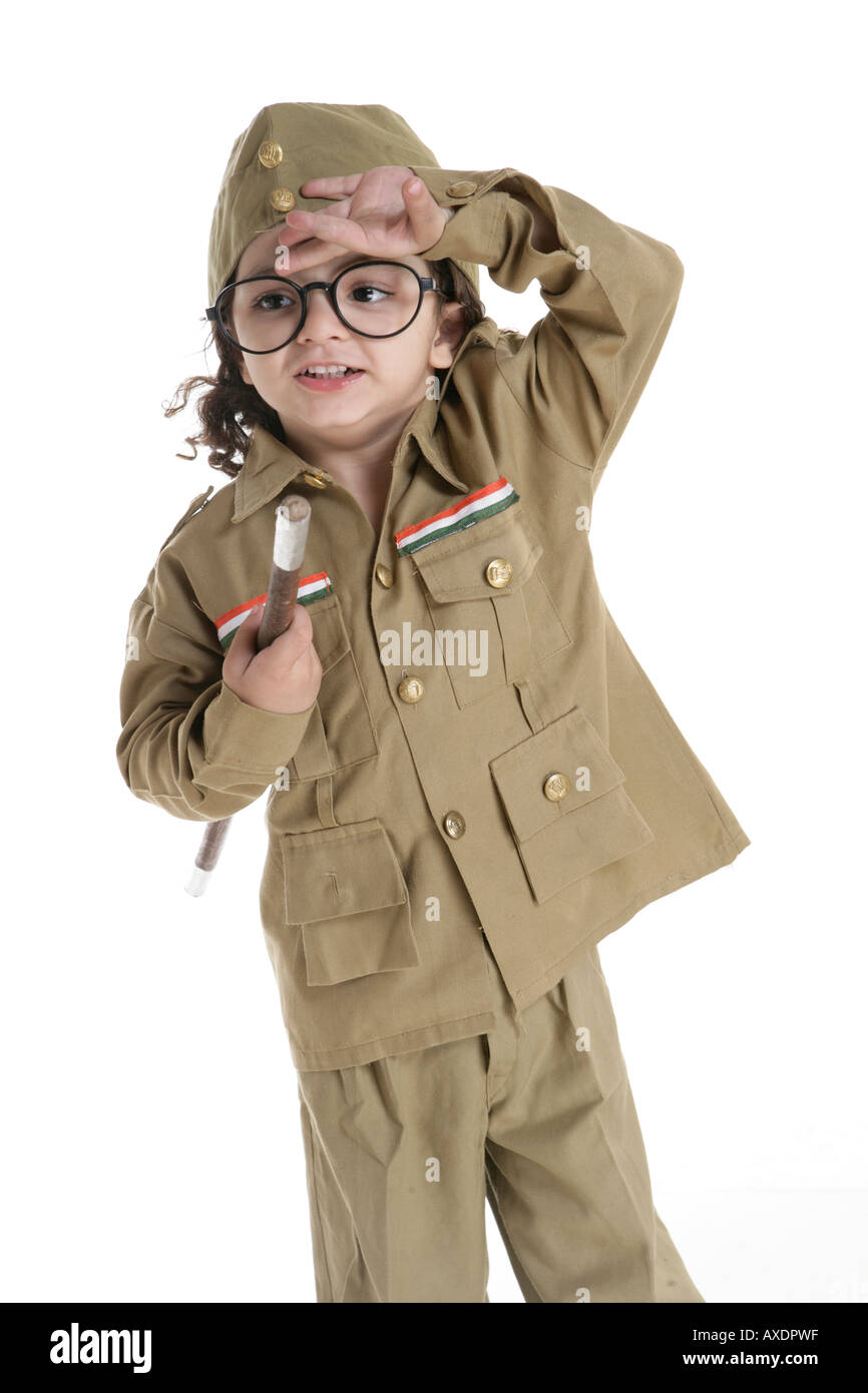 Portrait of a boy wearing policeman dress and uniform - Stock Image