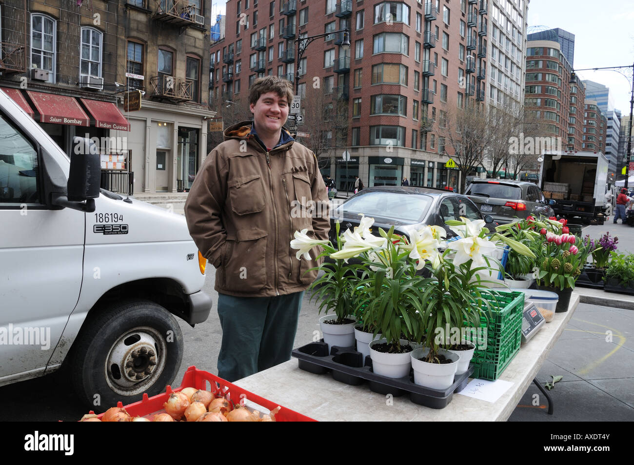 At the Greenmarket in Tribeca, Ryan Denerley sells produce and flowers from the John D. Madura farm in Pine Island, Stock Photo