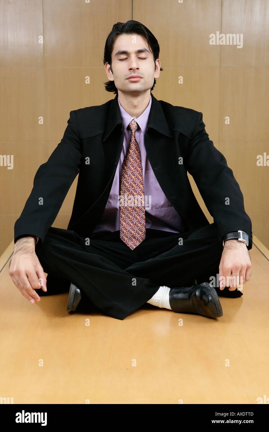 meditation businessman office. Businessman Doing Yoga In An Office Table - Stock Image Meditation