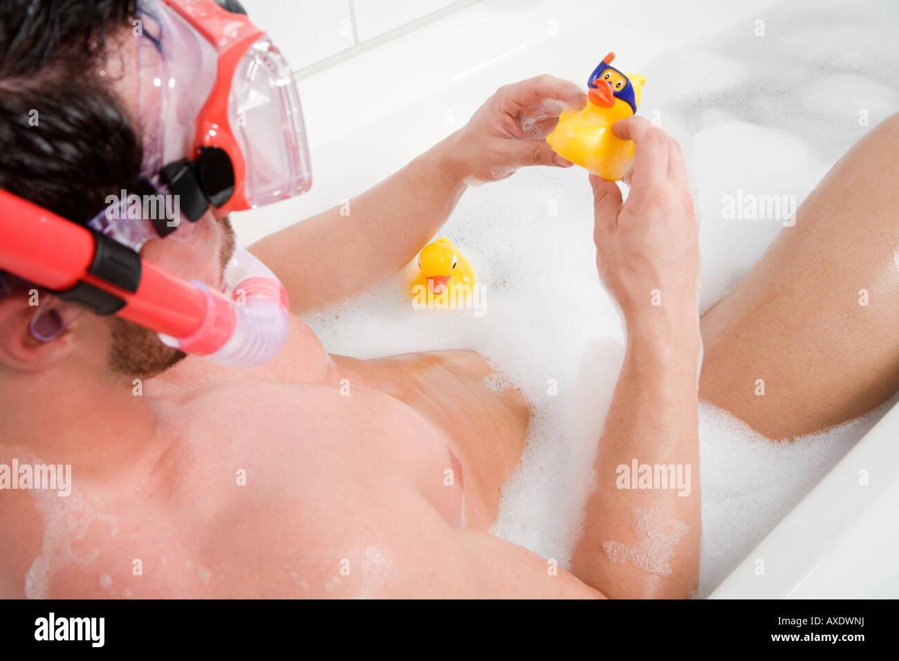 Man in bathtub with rubber duck, portrait Stock Photo: 16814477 - Alamy