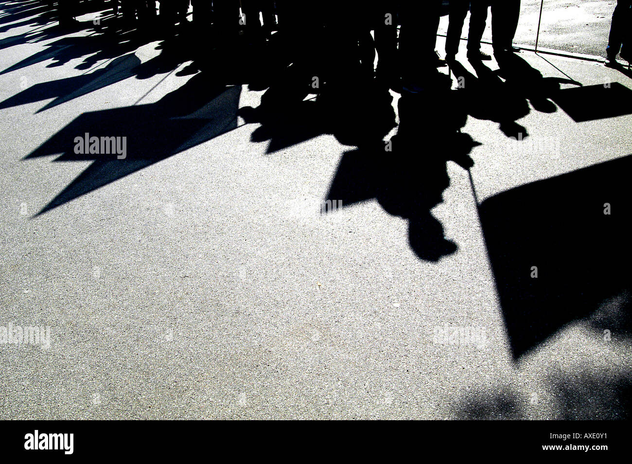 Shadow of demonstrators - Stock Image