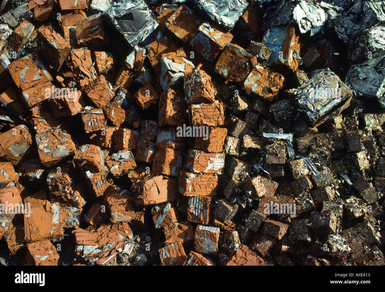 Pile of steel scrap metal industrial waste crushed recycled car bodies waiting to be melted down recycled at iron foundry - Stock Image