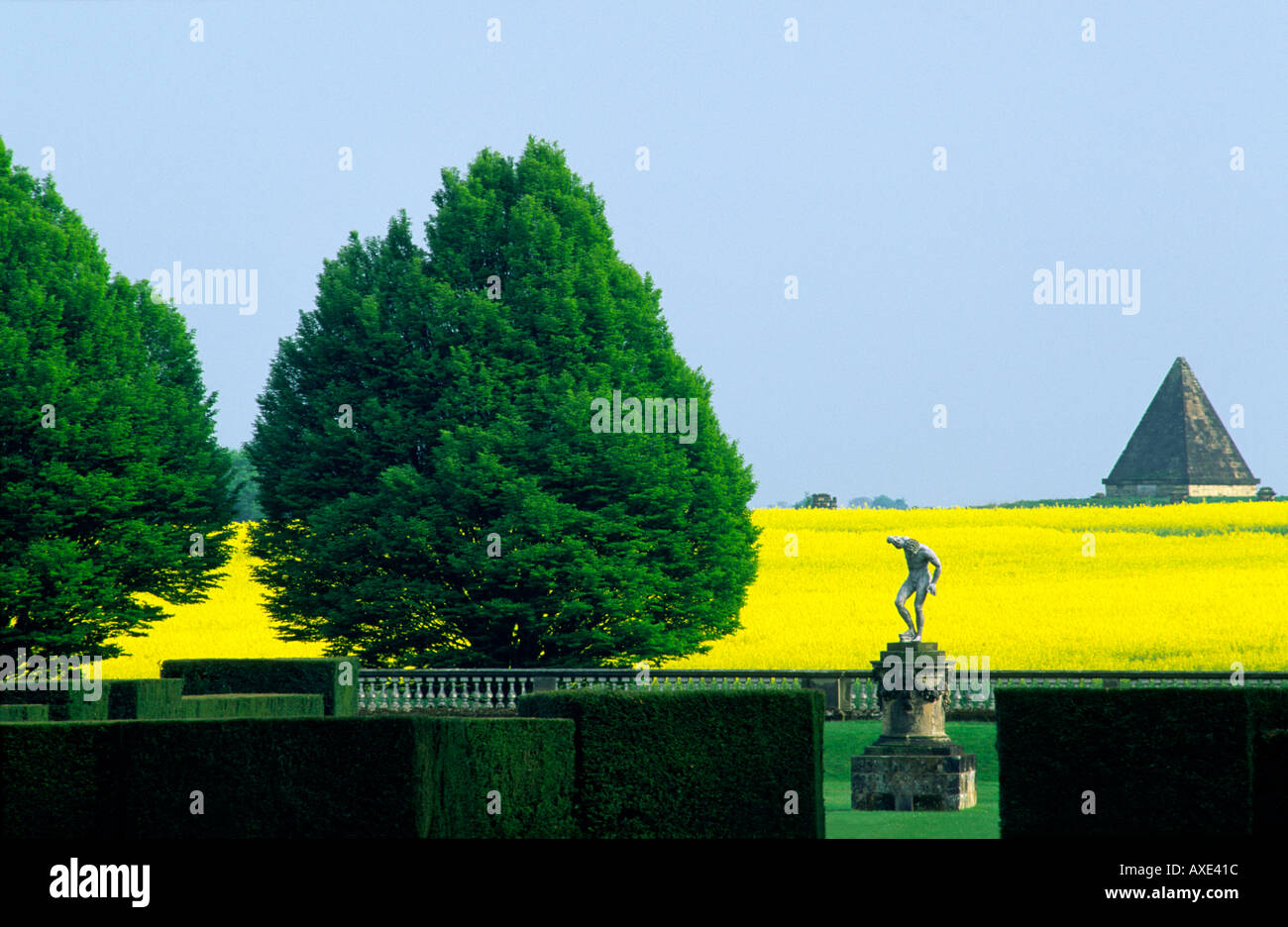 Castle Howard stately home mansion in North Yorkshire, England. Garden detail statue The Dancing Faun circa 1740. - Stock Image