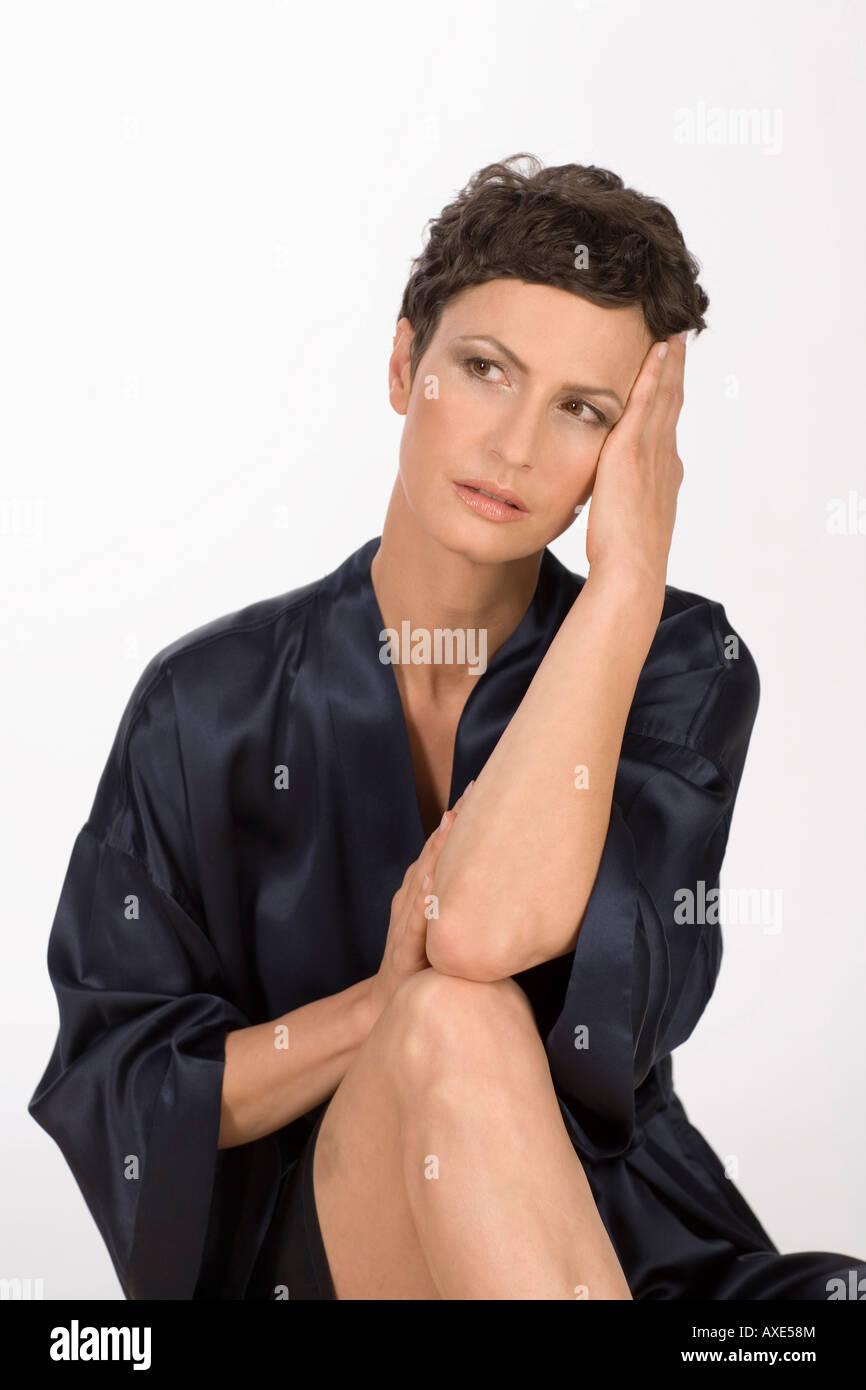 Woman with headache, portrait - Stock Image