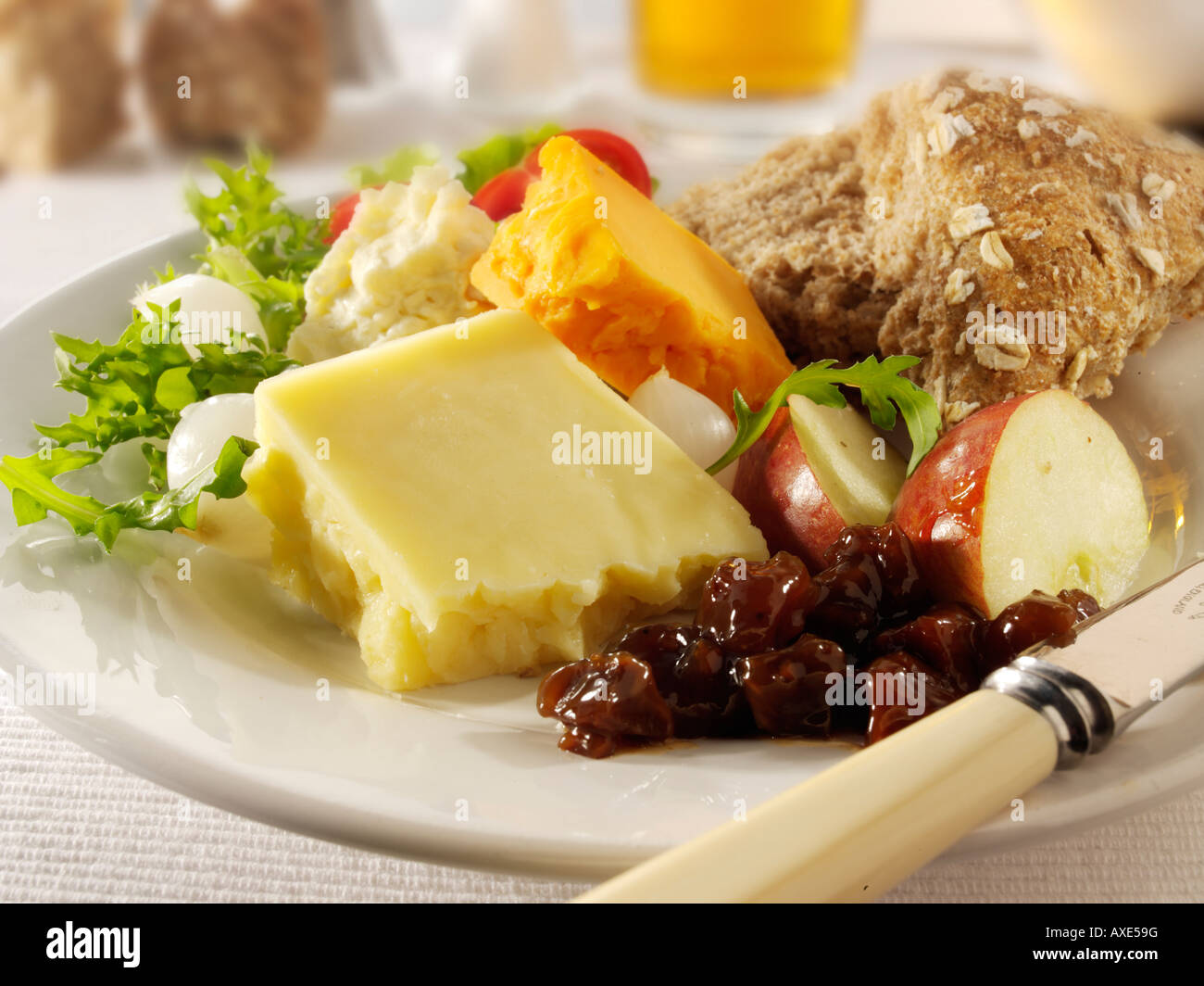 Traditional cheese Ploughman's with Cheddar & Red Leicester in a pub setting - Stock Image