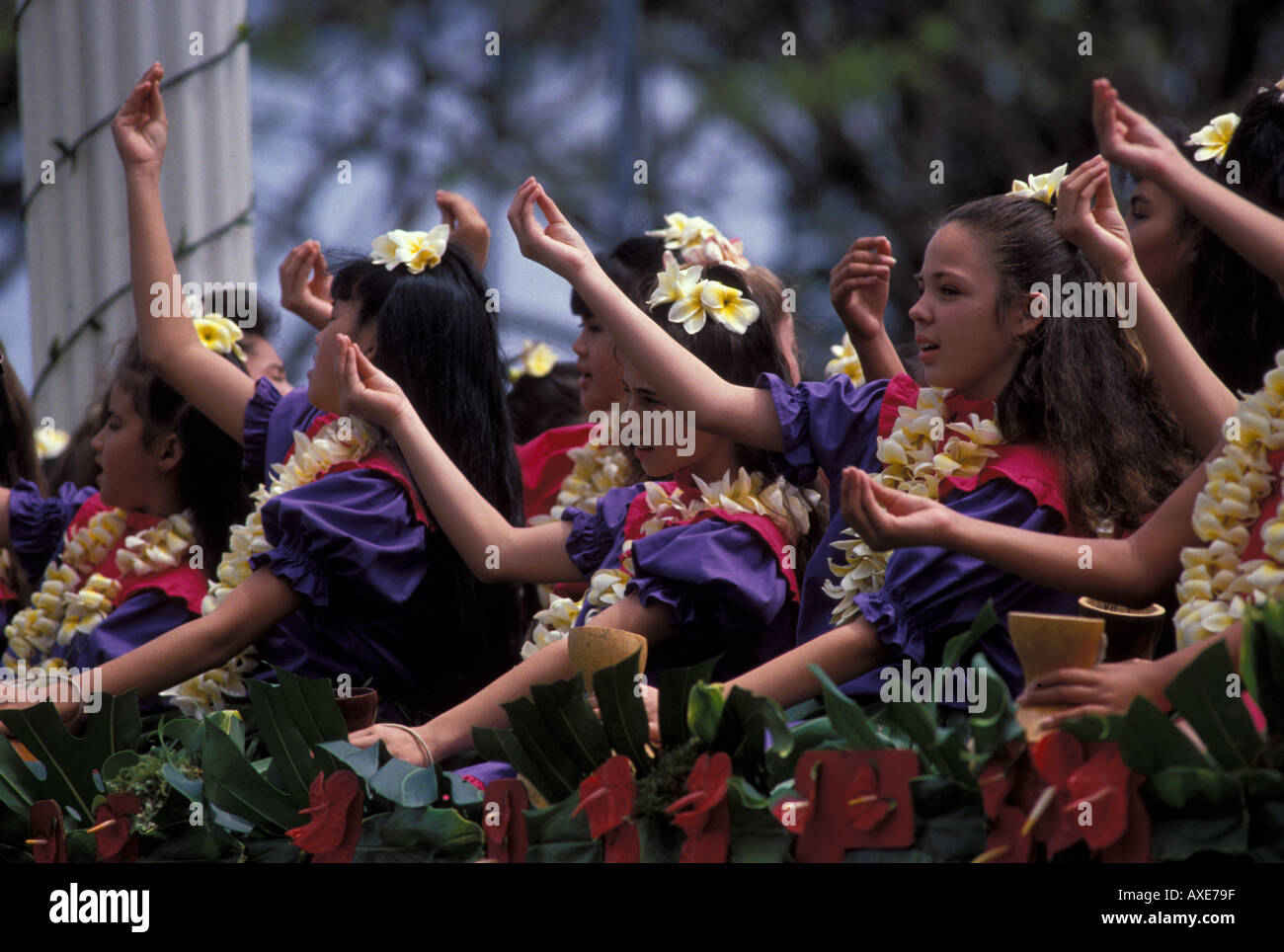 Hula dancer girls on float with leis Merry Monarch Festival parade Hilo Big Island Hawaii - Stock Image