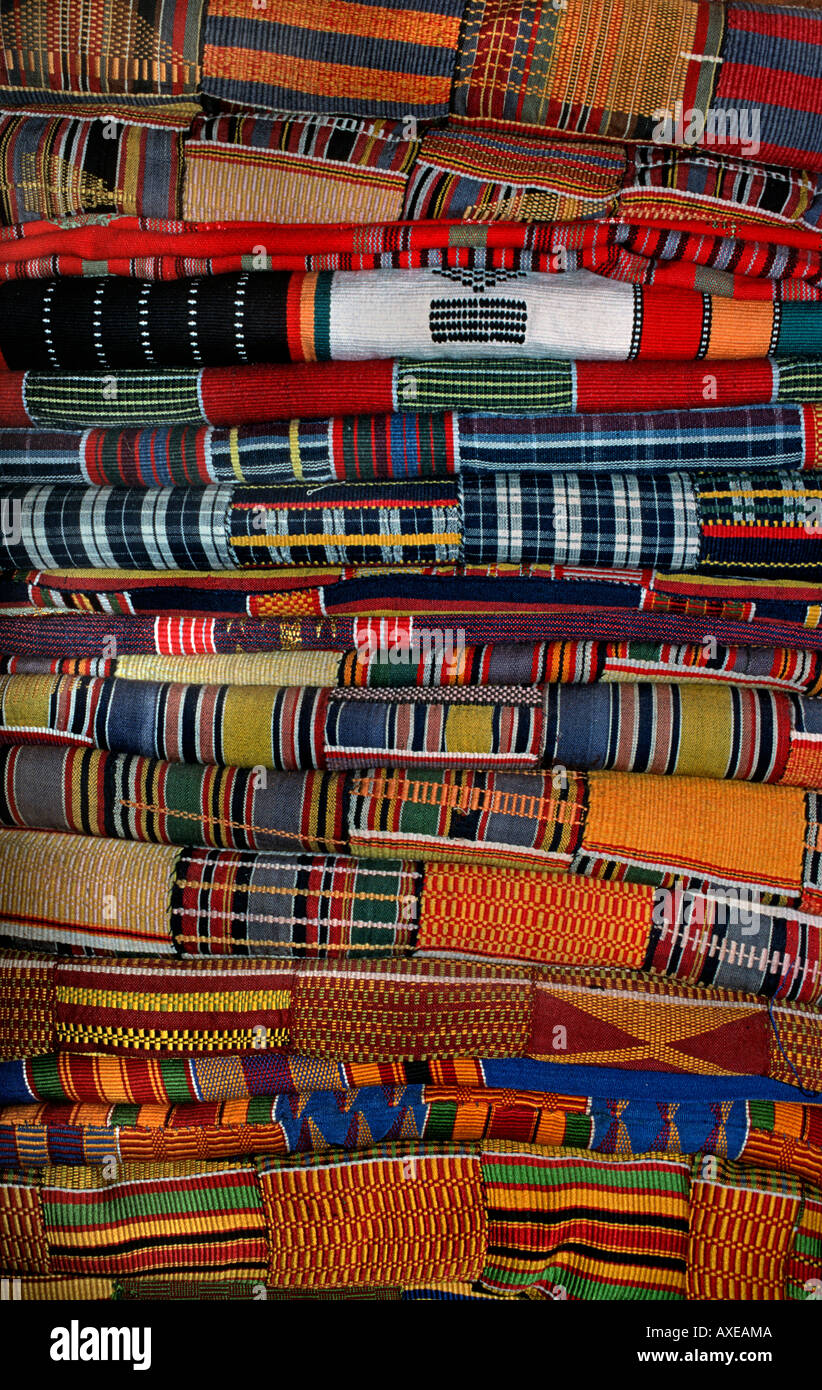 Stack of brightly coloured West African strip textiles Ewe fabrics from Ghana - Stock Image