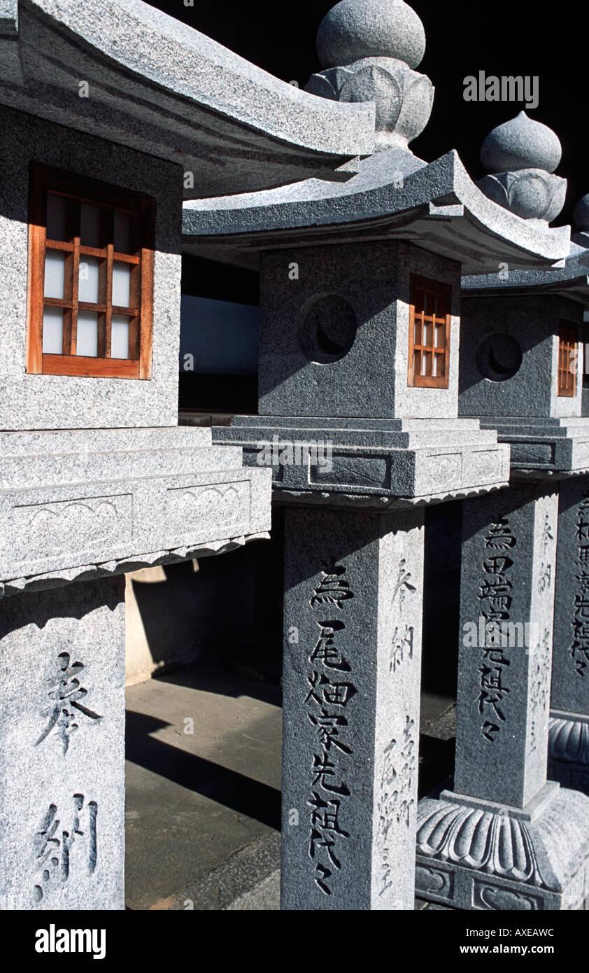 Details of stone lanterns at a Japanese buddhist temple Tsubosaka dera temple Nara prefecture Japan Historic temple - Stock Image