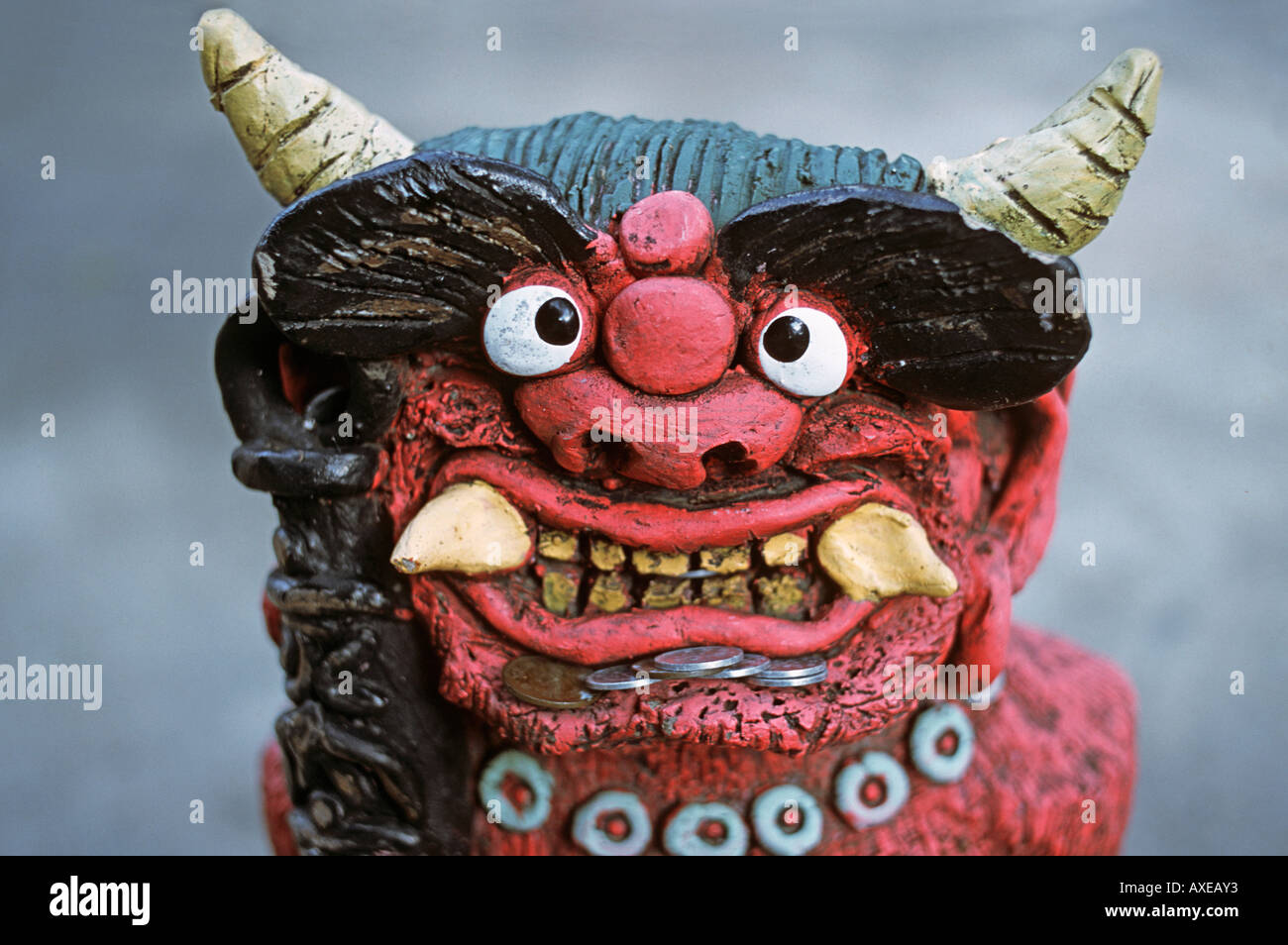 Small devilish oni statue with fearsome features Good luck charm Tsubosaka dera temple Nara prefecture Japan - Stock Image