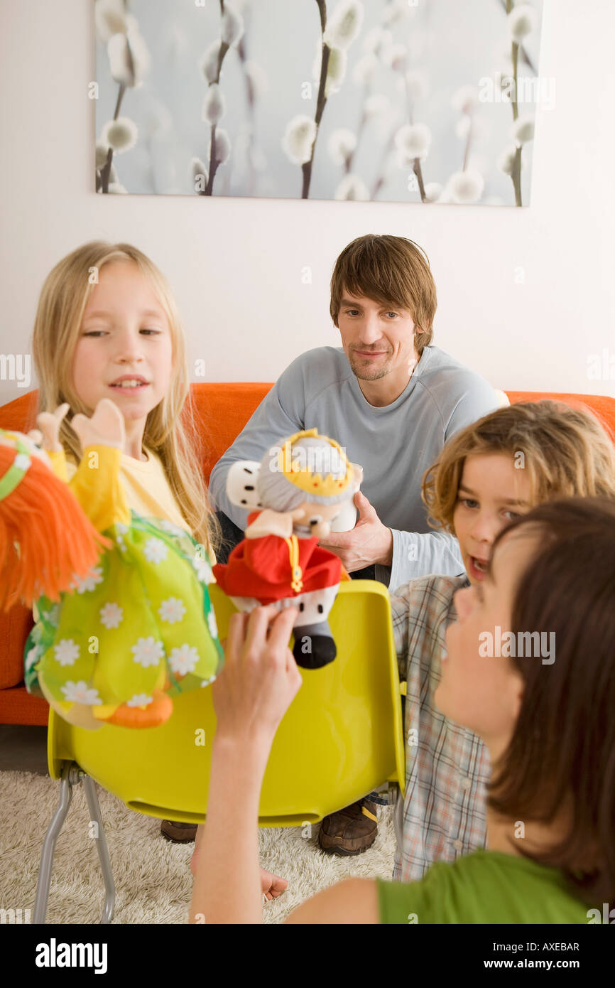 Family playing with glove puppets Stock Photo