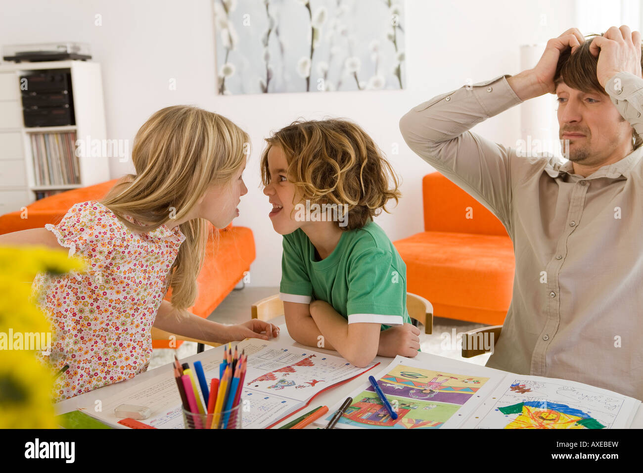 Boy (6-7) and girl (8-9) angry with each other - Stock Image