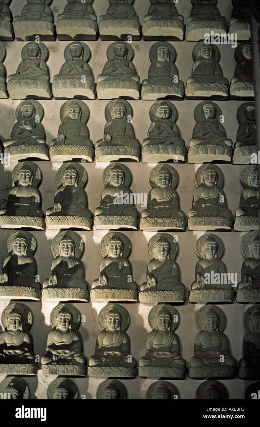 A wall of small buddhist statues at Tsubosaka dera temple Nara prefecture Japan Historic temple - Stock Image