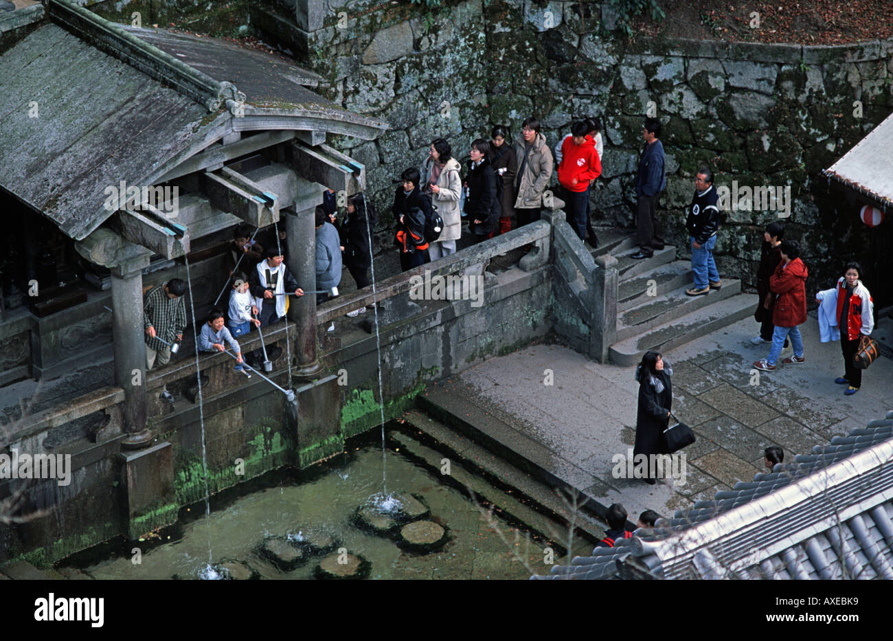 Sacred site for blessing with water from a mountain spring Water temple at Kiyomizu dera One of Kyoto s defining sights JAPAN - Stock Image