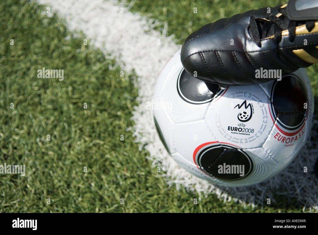 the foot of a football player on a Replica of EUROPASS the official matchball of the European football Tournament Stock Photo