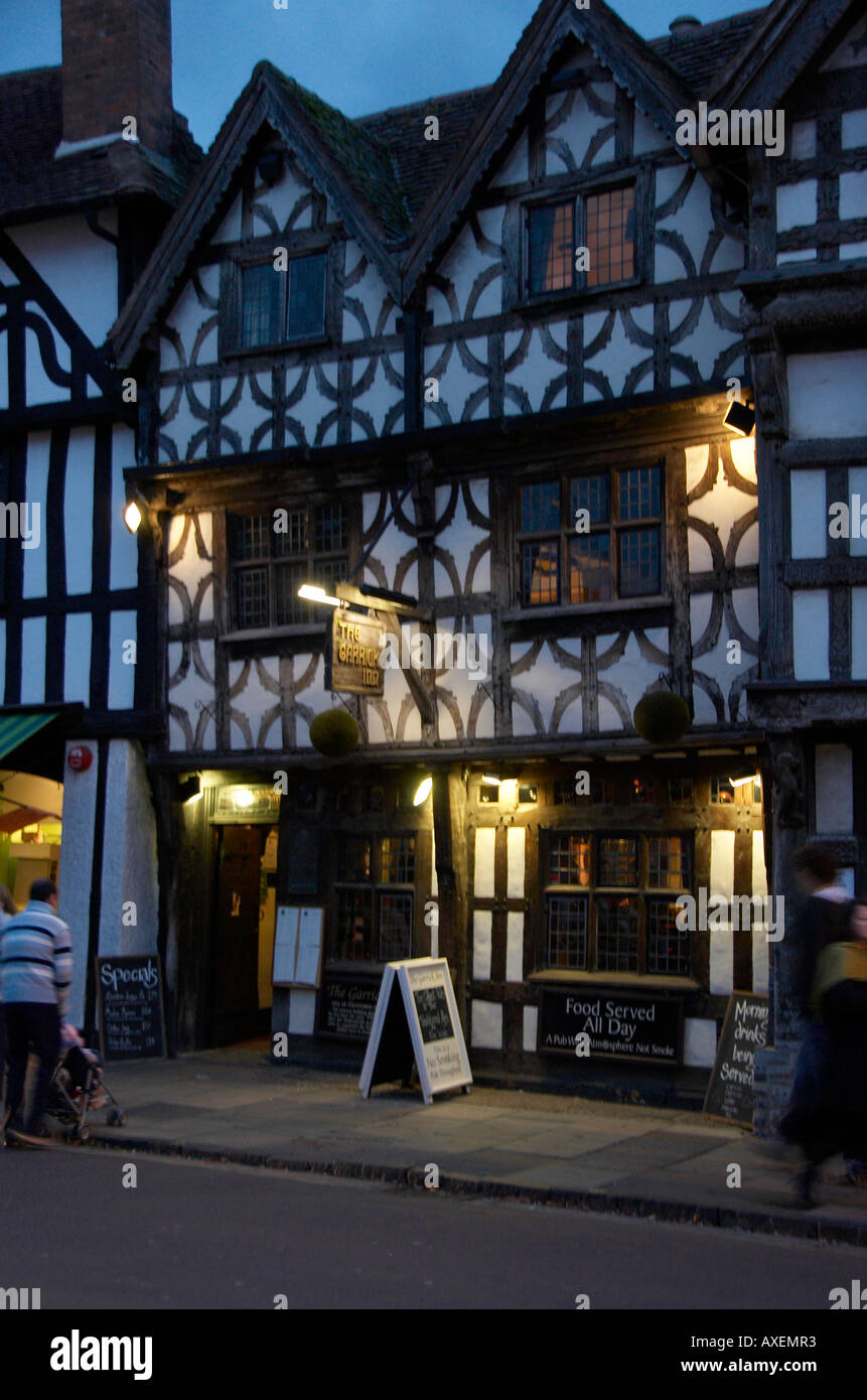 Lit exterior of the 16th century Garrick Inn in Stratford-upon-Avon at down - Stock Image