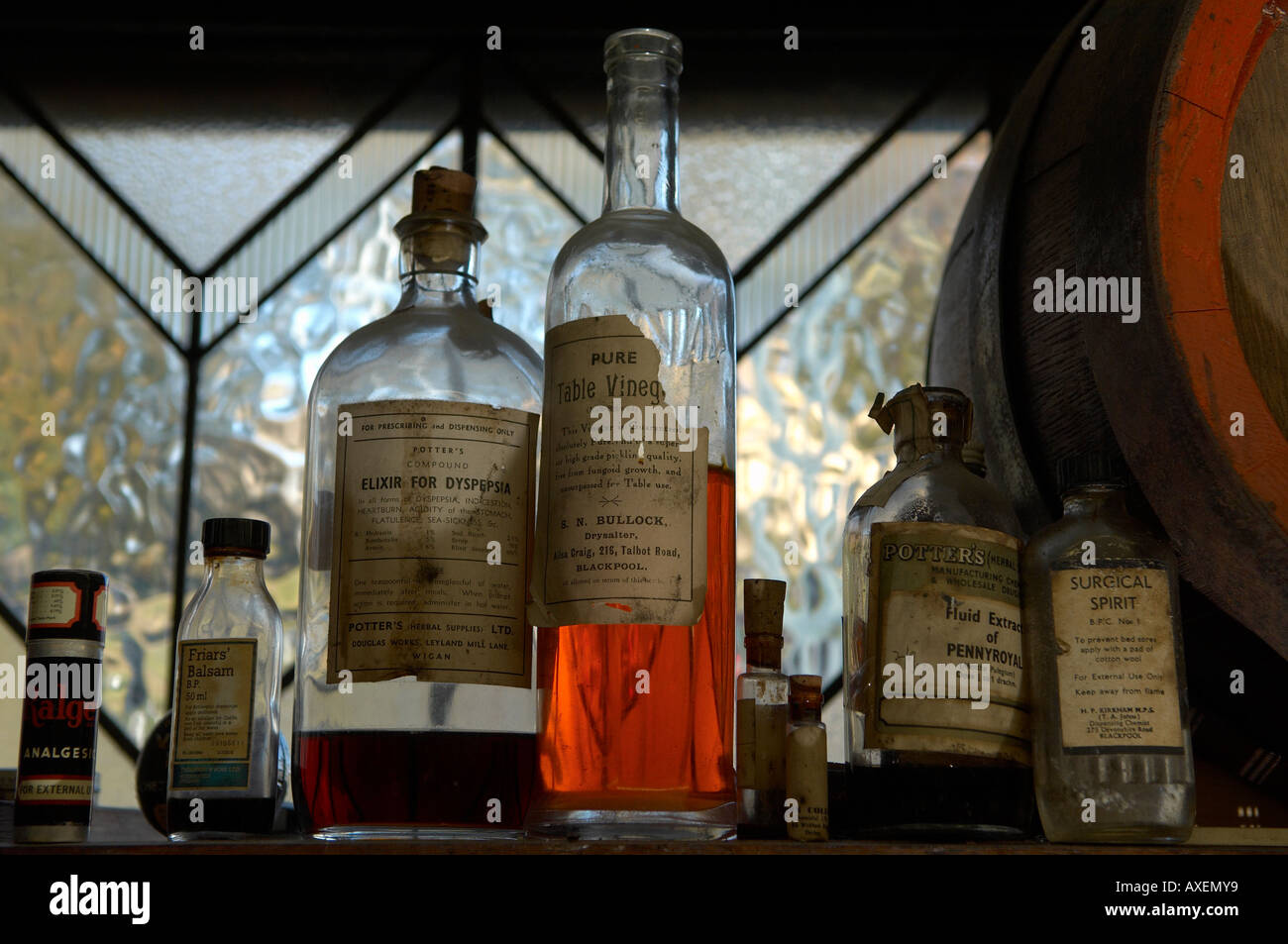 Old apothecary bottles on a shelf. Stock Photo