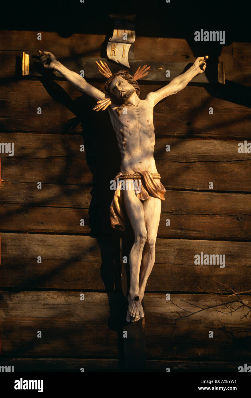 A crucifix nailed to the outside of a barn in Balzers, Principality of Liechtenstein. Stock Photo