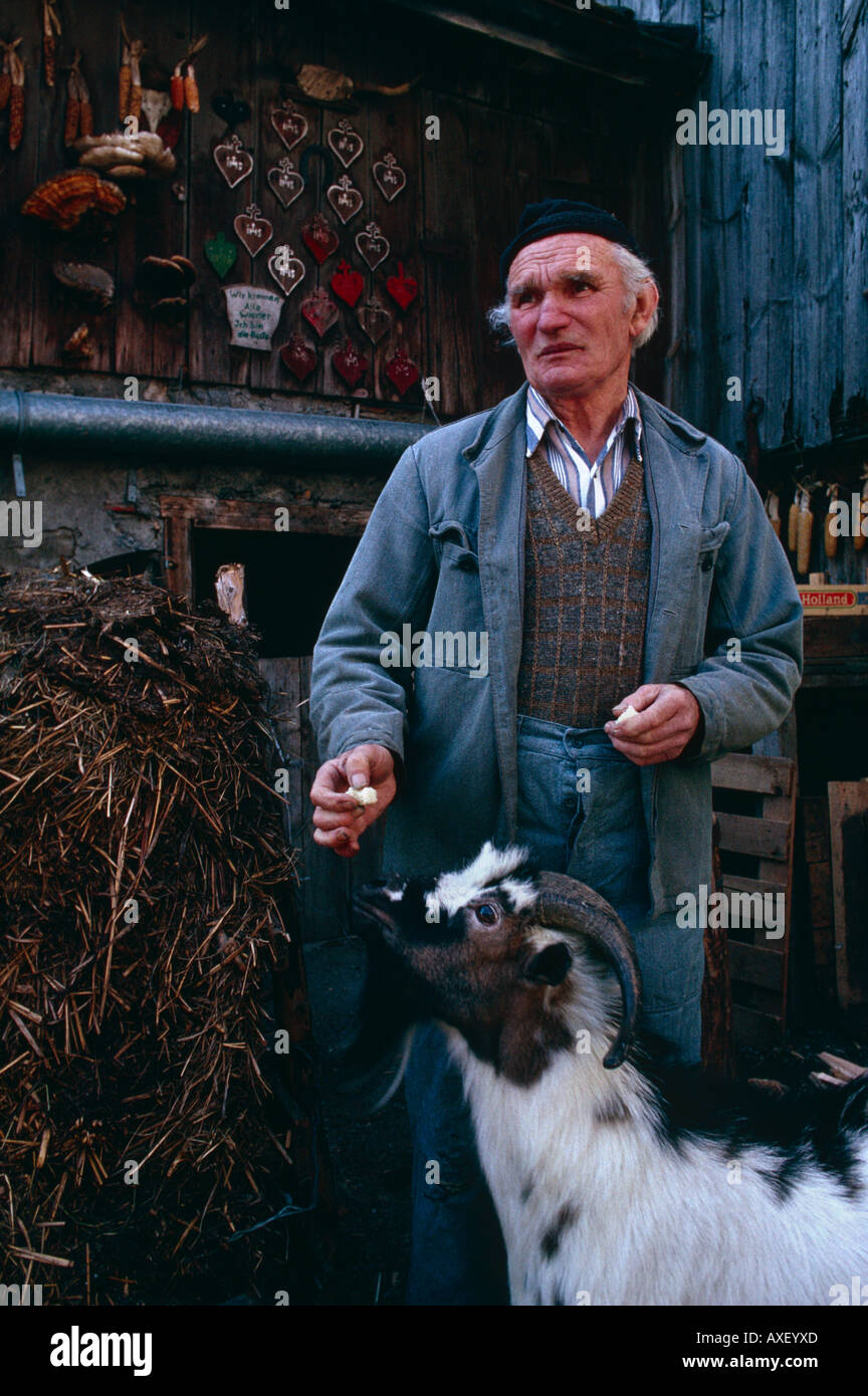Traditional farmer Peter Eberle in the courtyard of his smallholding in Balzers, Principality of Liechtenstein Stock Photo