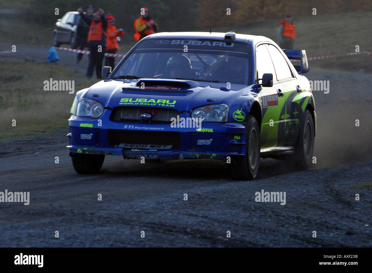 petter solberg wrc rally champion at speed in the welsh forests - Stock Image
