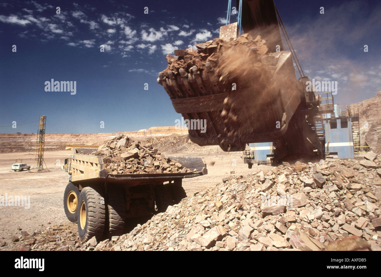Large digger loading rock and ore on to a truck in an open cast diamond mine Botswana Africa - Stock Image
