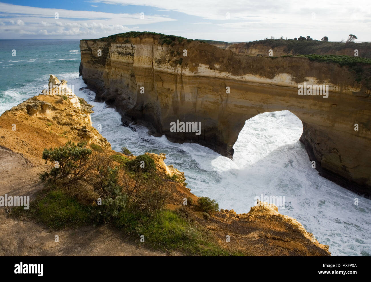 Rocky archway off the Great Ocean Road in South Australia - Stock Image