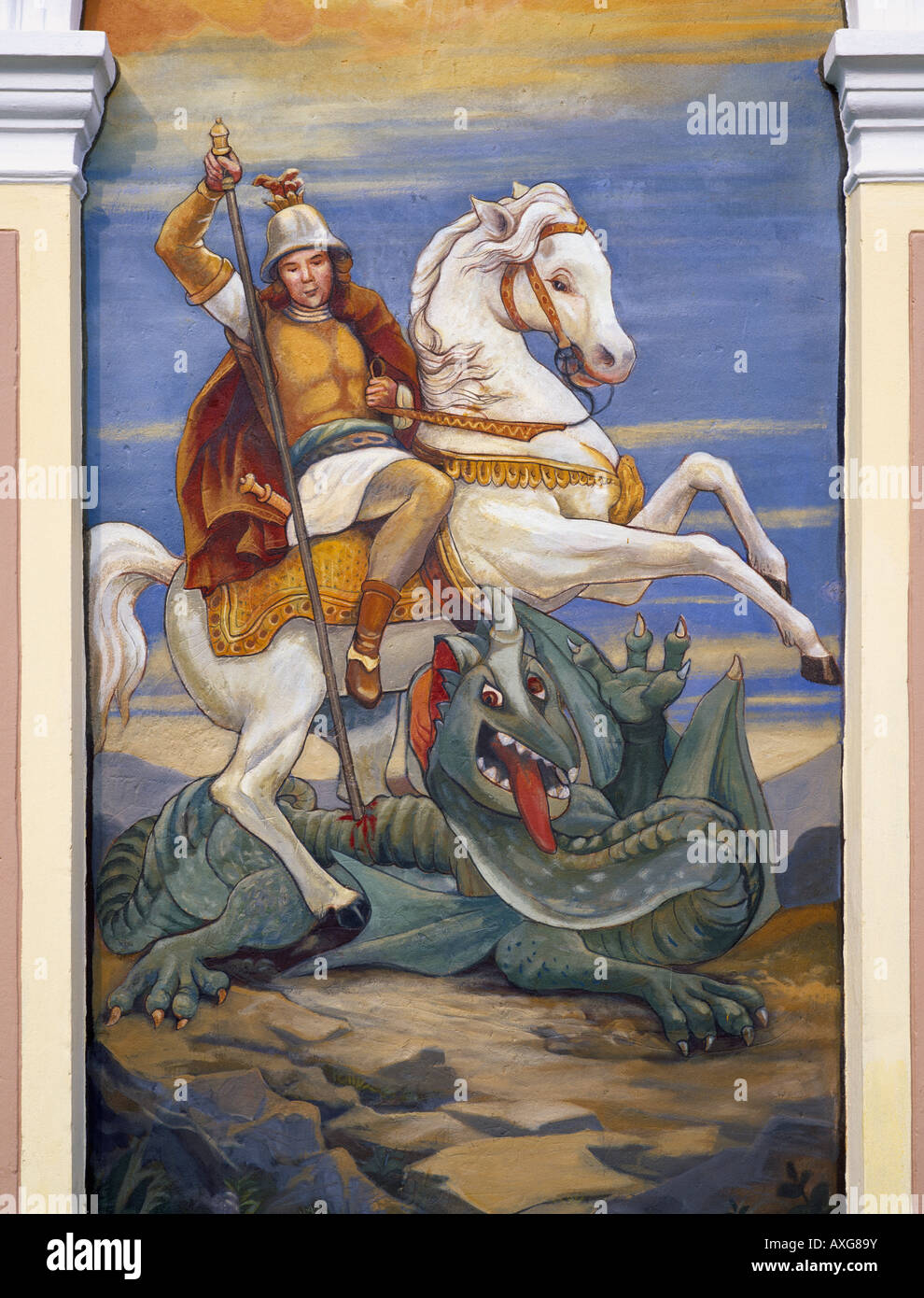 A mural on a roadside shrine depicting St George slaying the dragon. Located near Bled, Gorenjska, Slovenia. - Stock Image