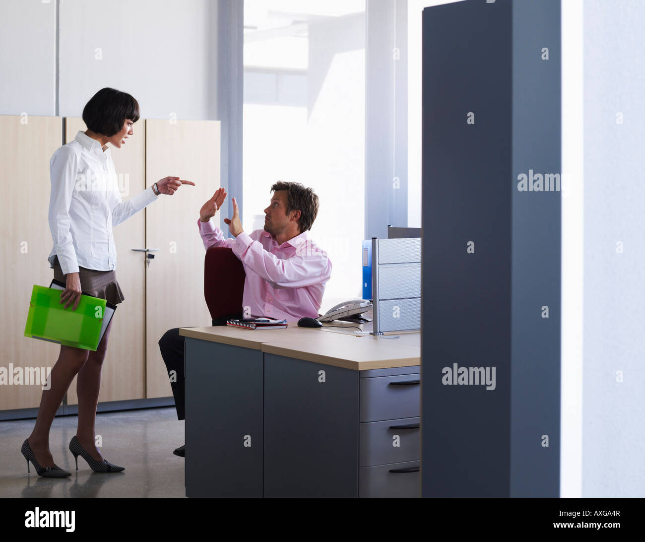 Coworkers Arguing in Office Stock Photo
