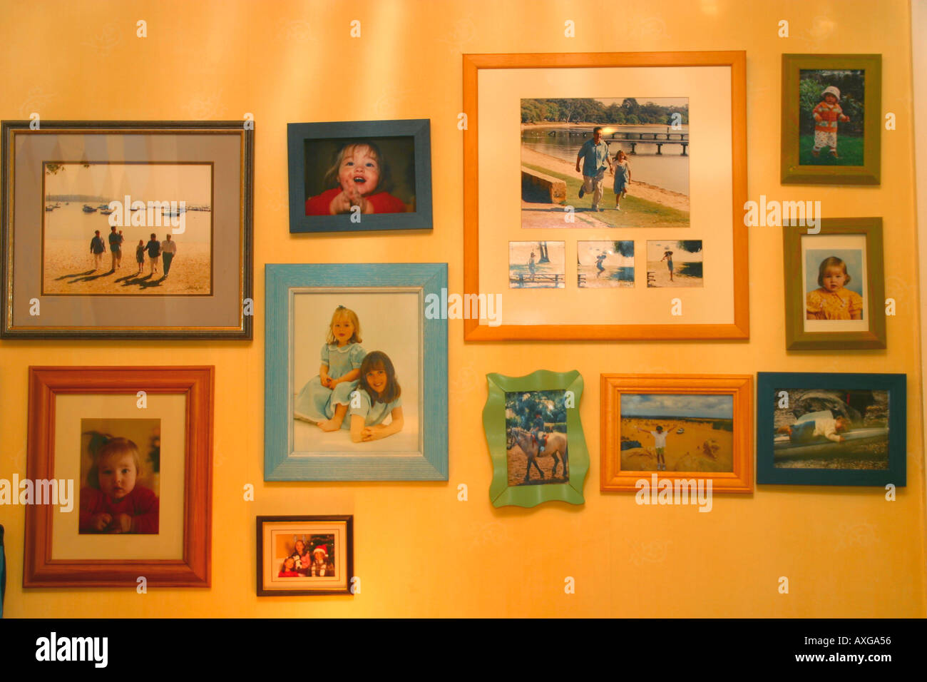 Nostalgia concept showing collection of family snapshots on house wall - Stock Image