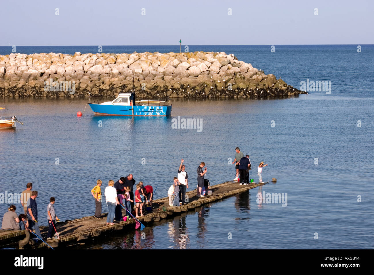 People fishing and crabbing at Rhos on Sea Colwyn Bay North Wales - Stock Image