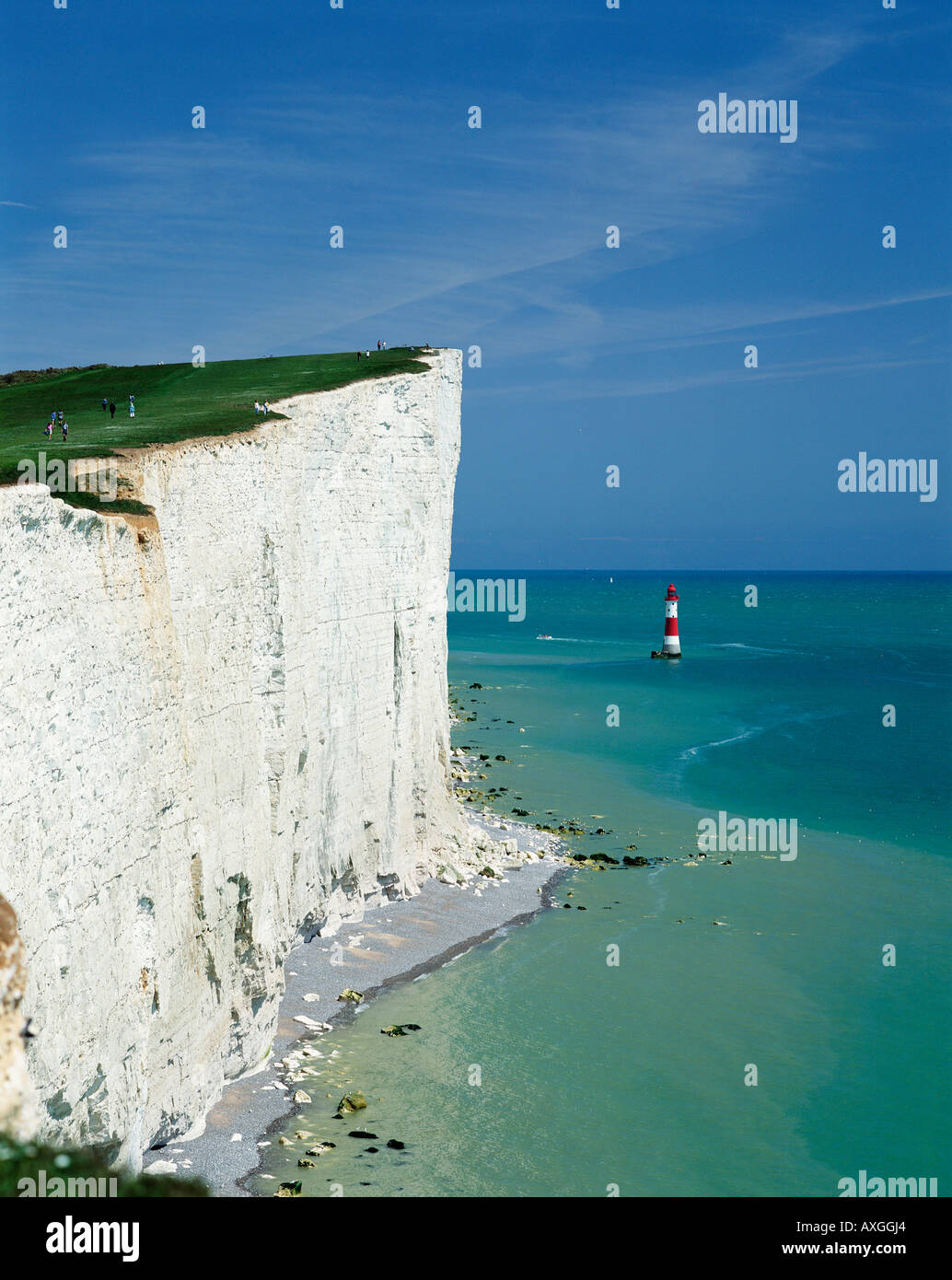 The white chalk cliffs of Beachy Head part of the Seven Sisters coastline and Beachy Head Lighthouse, near Eastbourne, East Sussex, England, UK, GB - Stock Image