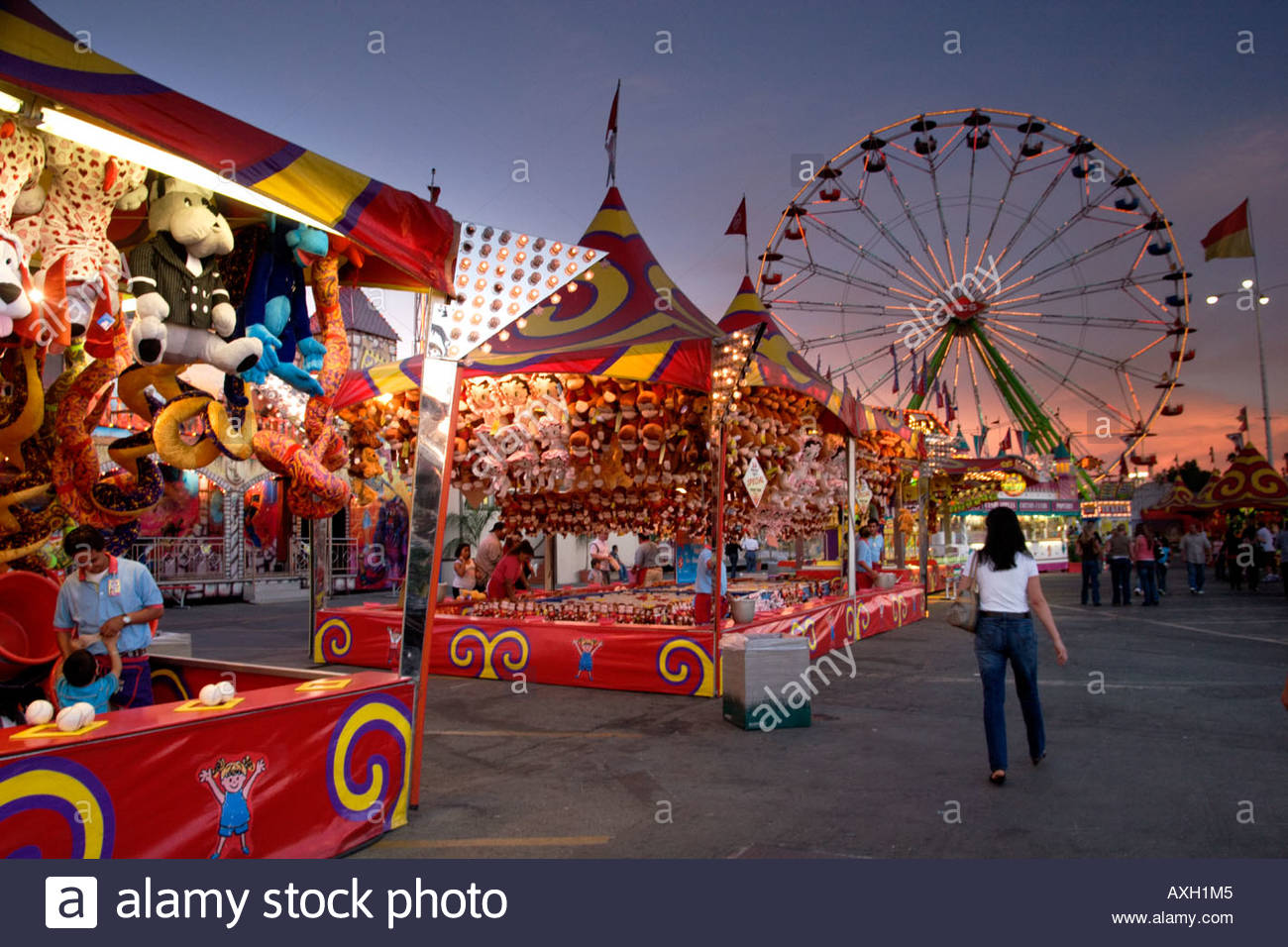 Boy and Father Playing at the Midway L A County Fair Pomona California - Stock Image