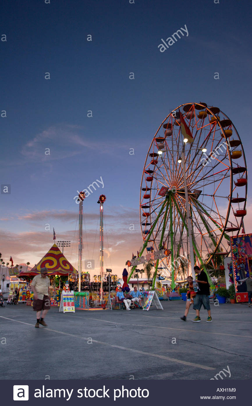 Ferris Wheel and Carnival Games at Sunset Los Angeles County Fair Pomona California - Stock Image