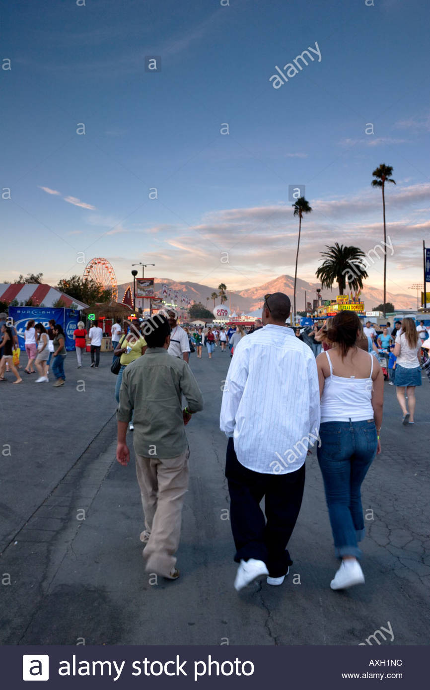 People Walking Towards Carnival at the L A County Fair Pomona California - Stock Image