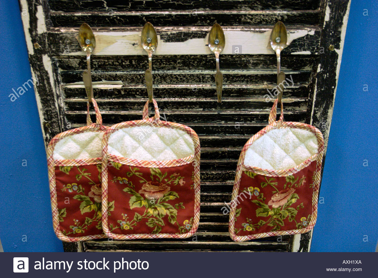 Oven Mitts Hanging off Spoons on a Door Los Angeles County Fair California - Stock Image