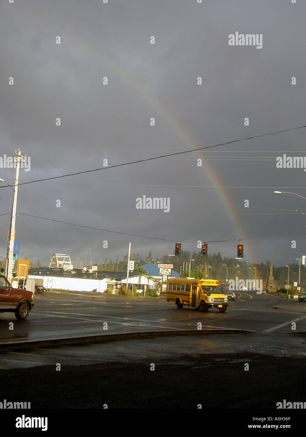 Rain bow lights the streets of Waldport on the Oregon Coast - Stock Image