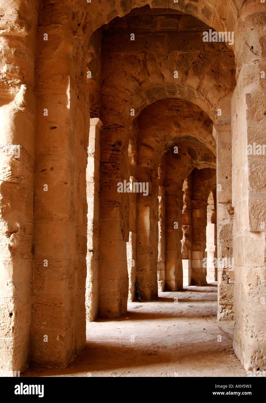 The great archway coridoor surrounding the Roman Amphitheatre of El Jem, Tunisia. - Stock Image