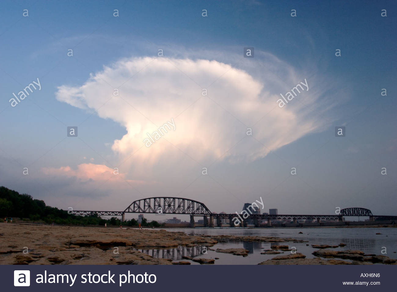 Cumulonimbus Clouds over Louisville from Falls of the Ohio State Park Clarksville Indiana - Stock Image