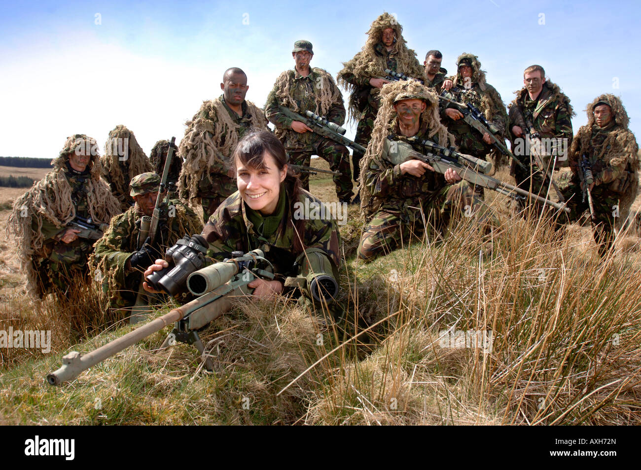 A BRITISH ARMY FEMALE RECRUIT AT A FIRING RANGE IN BRECON WALES DURING A SNIPER  TRAINING