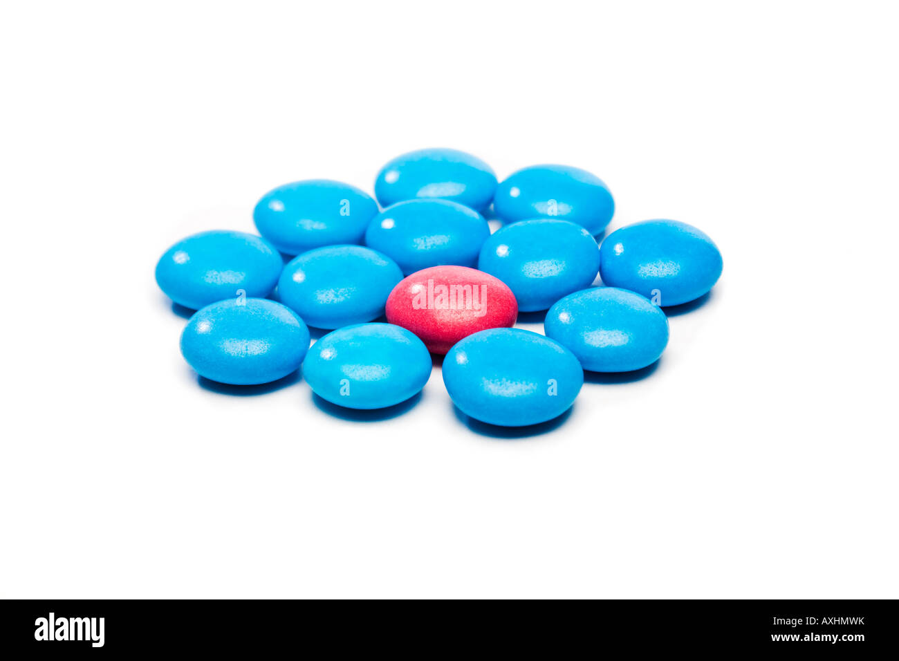 Coloured candy used to show the concept of protection, inclusion or individuality - Stock Image