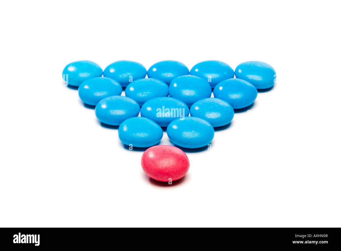 Coloured candy used to show the concept of leadership - Stock Image