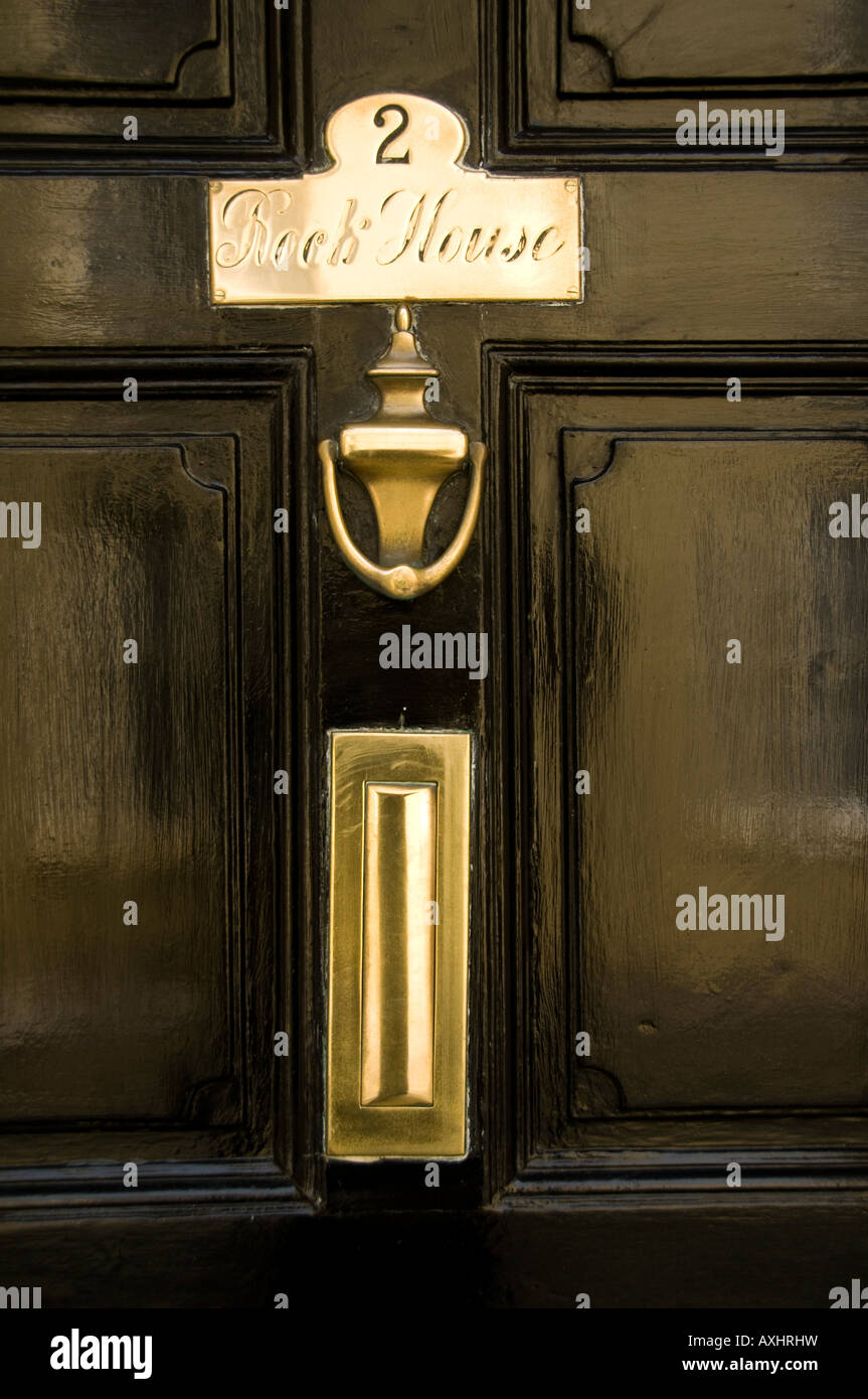 2 Rock House ; Polished Brass Door Knocker Name Plate And Letterbox On  Black Painted Wooden Door Tenby Pembrokeshire Wales UK