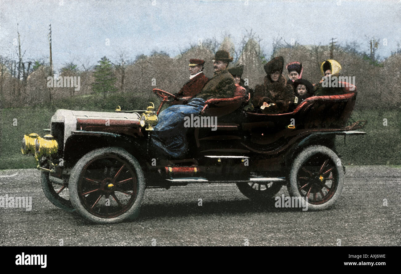 Family riding in a steam-powered White Company automobile 1907. Hand-colored halftone of a photograph - Stock Image