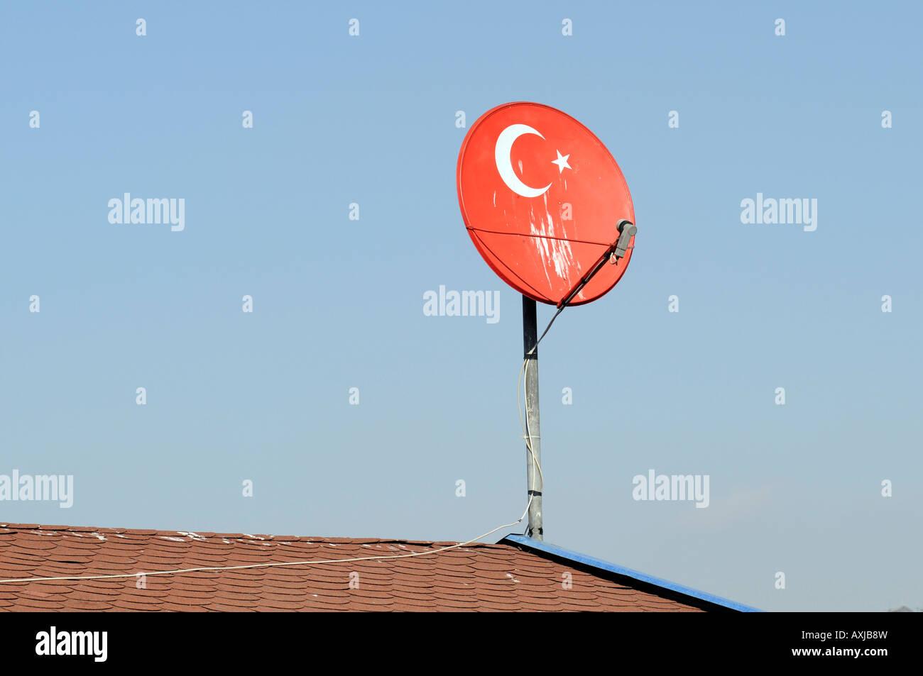 Satellite TV dish with the Turkish flag. Photo taken in Istanbul, Turkey. - Stock Image