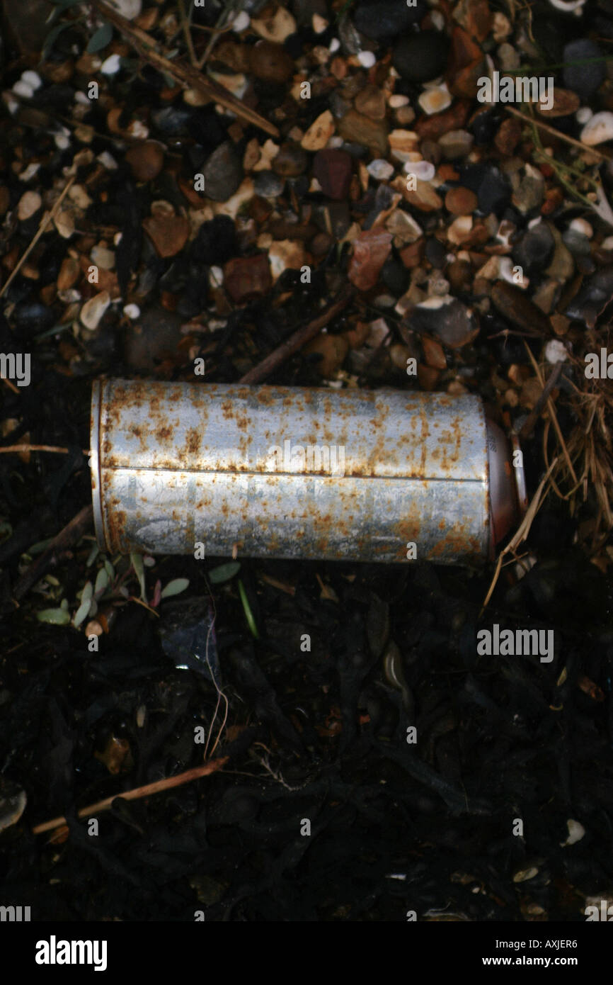 A compressed substance aerosol can lies discarded on the ground - Stock Image