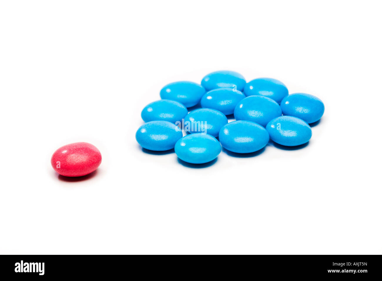 Coloured candy used to illustrate the concept of difference, exclusion or discrimination Stock Photo