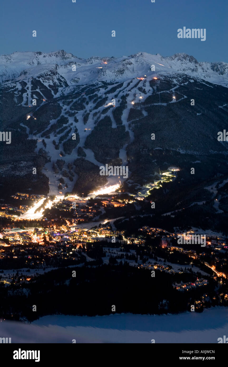 Whistler Village at dusk with Blackcomb and Whislter mountain beyond British Columbia Canada Stock Photo