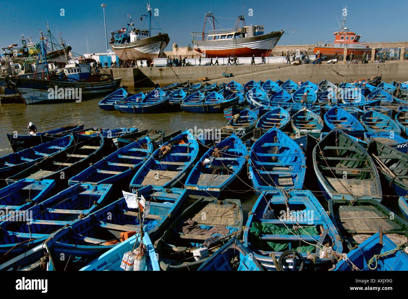 Small fishing boats in port Essaouria Morocco - Stock Image
