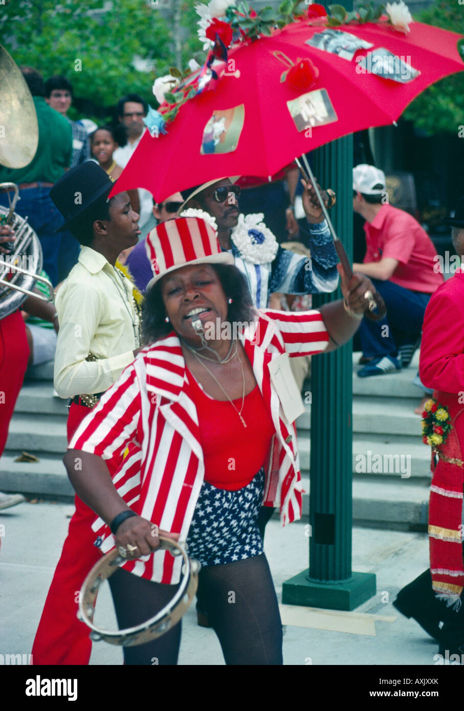 39ff1ec742 Afro American woman blowing whistle while in 4th of July Independence Day  parade New Orleans Louisiana USA