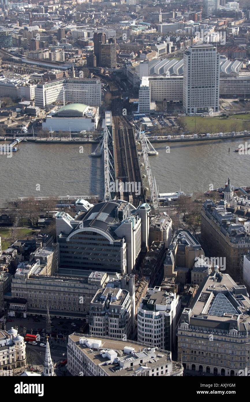 High level oblique aerial view south east of Charing Cross Station Hungerford Railway Bridge London WC2 and SE1 - Stock Image