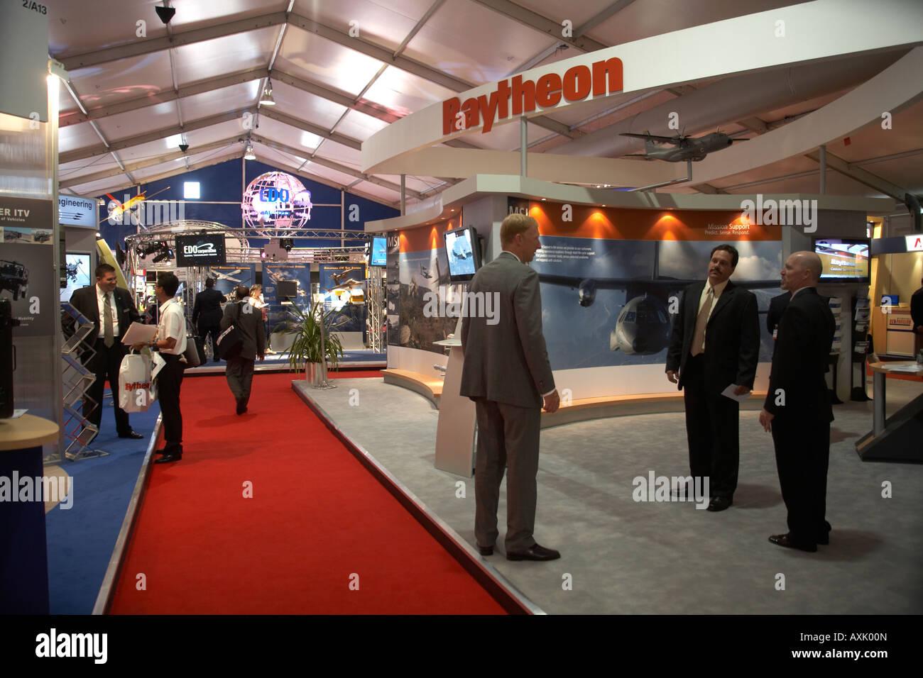 Raytheon and EDO exhibition display trade stand at Farnborough International Airshow July 2006 - Stock Image